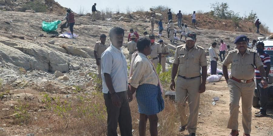 Police personnel inspect the quarry site where gelatin sticks exploded, killing six people, at at Hirenagavalli village, in Chikkaballapur district in the wee hours of Tuesday
