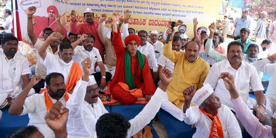 Panchamasali seer Sri J Mruthyunjaya Swami continues his dharna on Day 3 at Freedom Park, in Bengaluru on Tuesday demanding reservation.