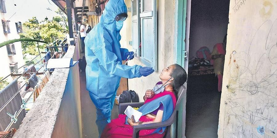 A health worker takes an RT-PCR test in Mumbai.