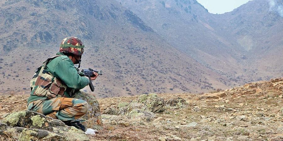 A security personnel during encounter at south Kashmir's Sirhama.
