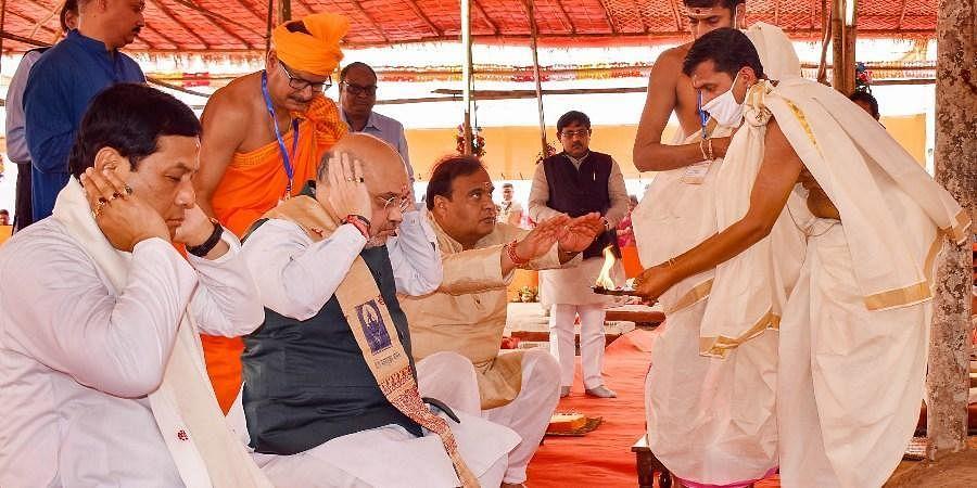 Union Home Minister Amit Shah and Assam Chief Minister Sabananda Sonowal pay obeisance at Maha Mrityunjay Temple near Puranigudam in Nagaon district of Assam Thursday