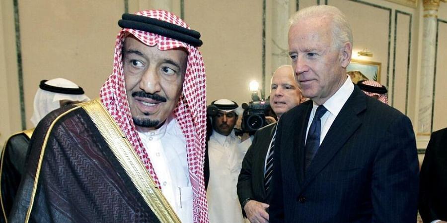 Then U.S. Vice President Biden, right, offers condolences to then Prince Salman bin Abdel-Aziz upon death of his brother Crown Prince Sultan bin Abdul-Aziz Al Saud.