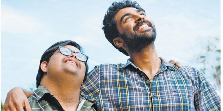 Thoma, and his Down syndrome-affected older brother, Sebu/Ismu, played by George Kora and Gopi Krishna Varma.