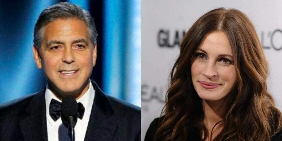Hollywood actors George Clooney and Julia Roberts (Photos   AP)