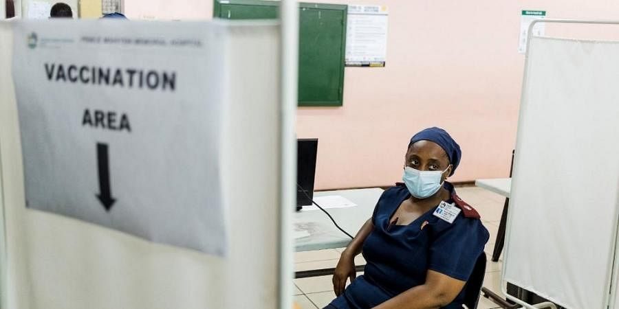 A nurse awaits to receive a dose of the Johnson & Johnson vaccine against the COVID-19 coronavirus. (Photo | AFP)