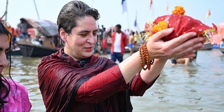 Priyanka Gandhitakes holy dip in Sangam. (Photo  Twitter/ Congress)