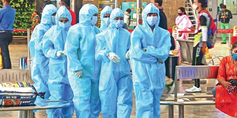 Healthcare workers arrive at CSMT railway station to screen passengers following the surge in Covid-19 cases in Mumbai. (Photo   PTI)