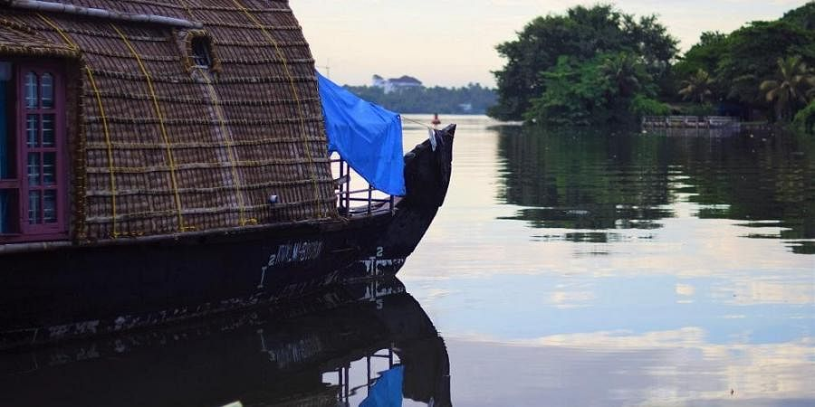 A houseboat closed for services during the COVID related lockdown in Kollam, Kerala