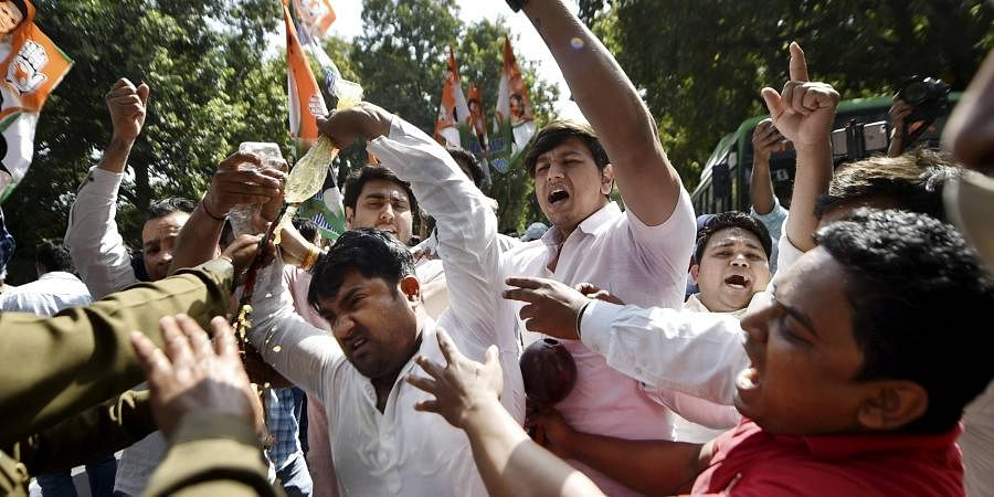 Indian youth Congress supporters take part in a demonstrative protest against the hike in fuel price. (Photo| PTI)