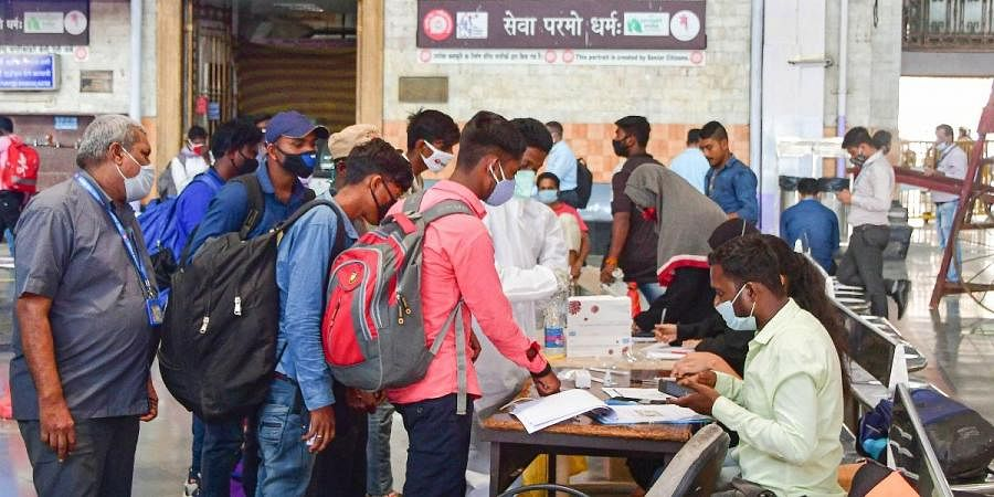 Passengers being screened for coronavirus tests at the CSMT railway station, owing to surge in COVID-19 cases in Mumbai, Friday, Feb. 26, 2021.