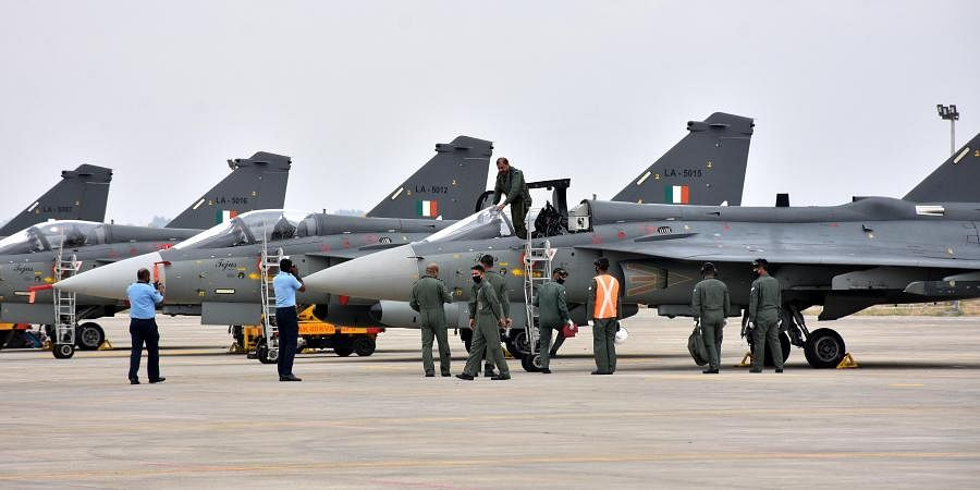 The Chief of the Air Staff Air Chief Marshal RKS Bhadauria getting down after flying the LCA Tejas MK-1 aircraft
