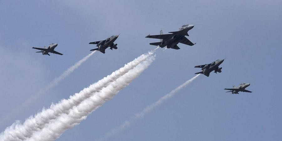 Indian Air Force's SU-30 aircraft in lead with two Jjaguar and two Hawk aircrafts fly in a formation over Yelahanka air base during Aero India. (Photo | Vinod Kumar T, EPS)