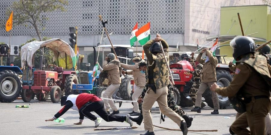 Police personnel start lathi-charge on protesting farmers at ITO during the tractor rally on Republic Day