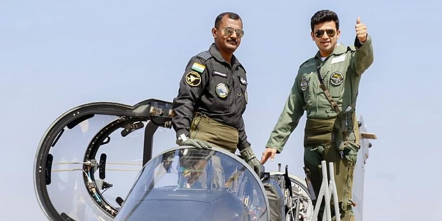 BJP MP Tejasvi Surya gestures as he boards a Light Combat Aircraft Tejas for a sortie during Aero India 2021, in Bengaluru. (Photo | PTI)