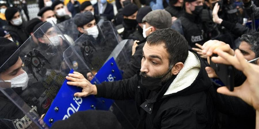 Turkish police officers clash with students of the Bogazici University protesting the appointment of a government loyalist to head their university, in Istanbul