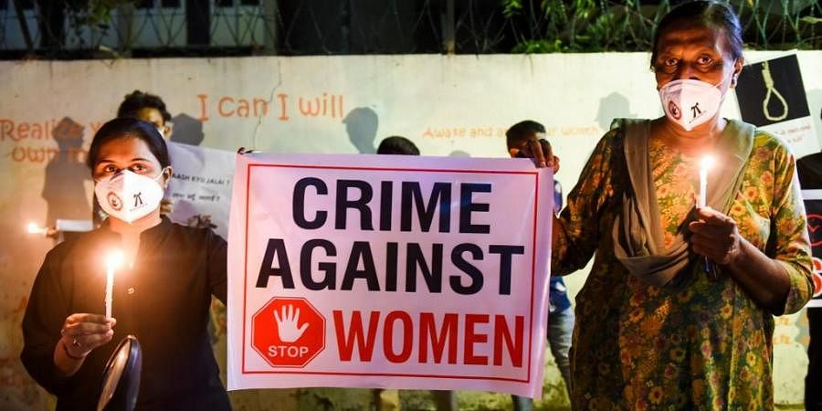 Lawyers display a placard to condemn the gang-rape and murder of a Dalit woman in Uttar Pradesh. (Photo| AFP)