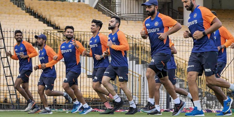 Indian cricket team captain Virat Kohli with teammates during a training session at MA Chidambaram Stadium in Chennai. (Photo   PTI)