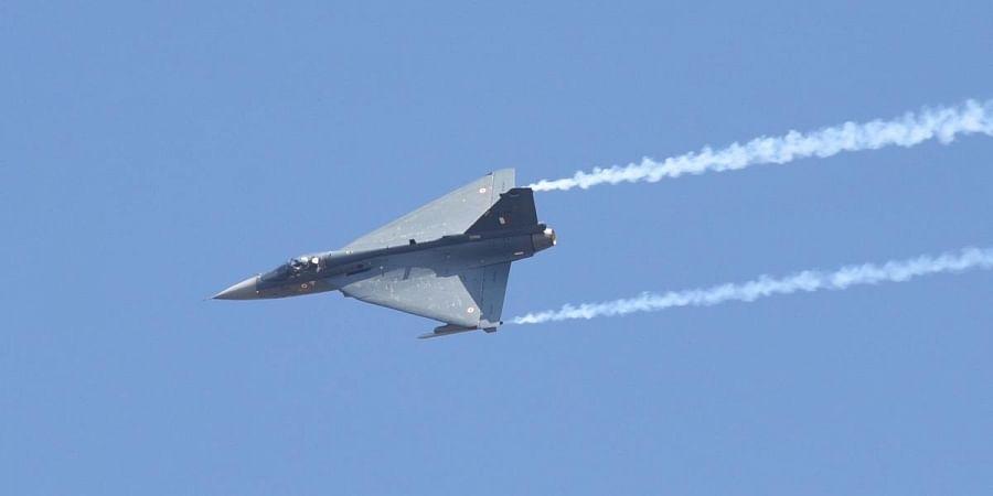 IAF aircraft Tejas flies past Yelahanka air base during  Aero India in Bengaluru. (Photo | Vinod Kumar T, EPS)