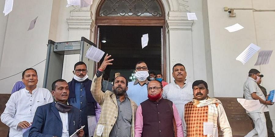 BJP MLAs stage a walkout from the West Bengal Assembly during presentation of state budget statement and vote on account by Chief Minister Mamata Banerjee.