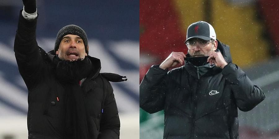 Manchester City manager Pep Guardiola (L) andLiverpool manager Jurgen Klopp