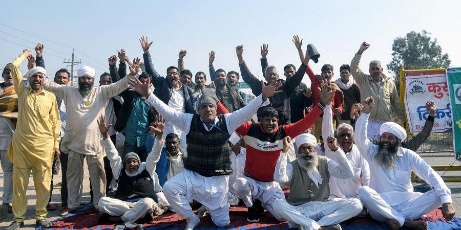 Protesting farmers during the Chakka jam called by them against farm laws, at Delhi Rohtak corridor near Tikri Border in Haryana