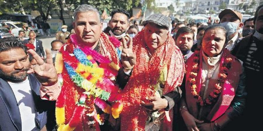 BJP leaders celebrate with their supporters after being elected as DDC chairman and vice-chairman in Jammu on Saturday | PTI