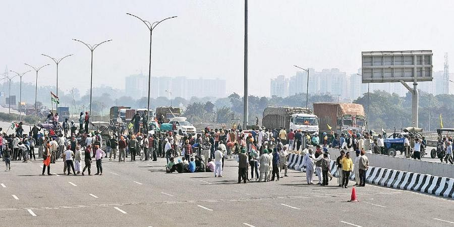 Farmers block the Kundli-Manesar-Palwal expressway near the Singhu border in New Delhi during the countrywide chakka jam on Saturday   PARVEEN NEGI