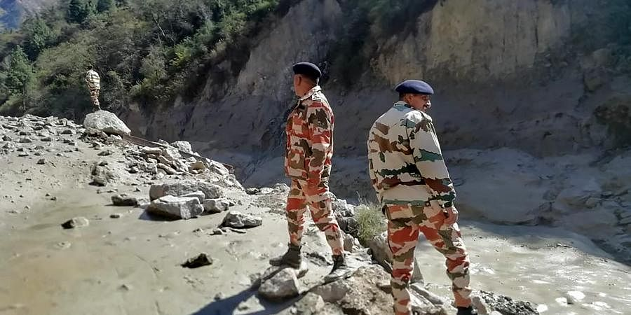 Indo-Tibetan Border Police personnel inspect the area damaged around Tapovan and Reni, after a glacier broke off in Joshimath
