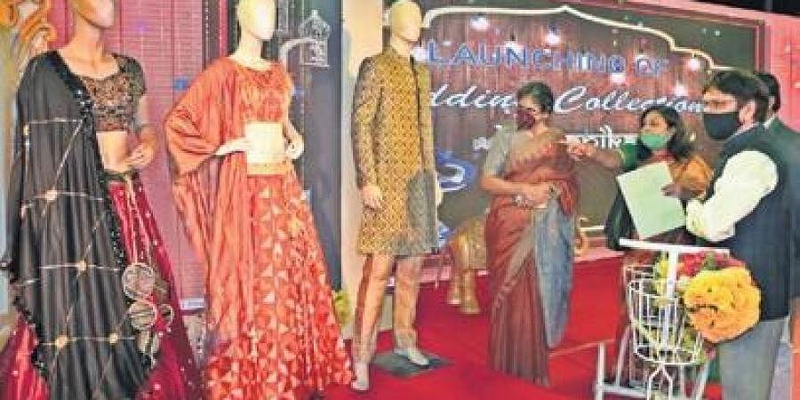 Handlooms and Textiles Secretary Shubha Sarma launching Boyanika's wedding collection  in Bhubaneswar on Sunday