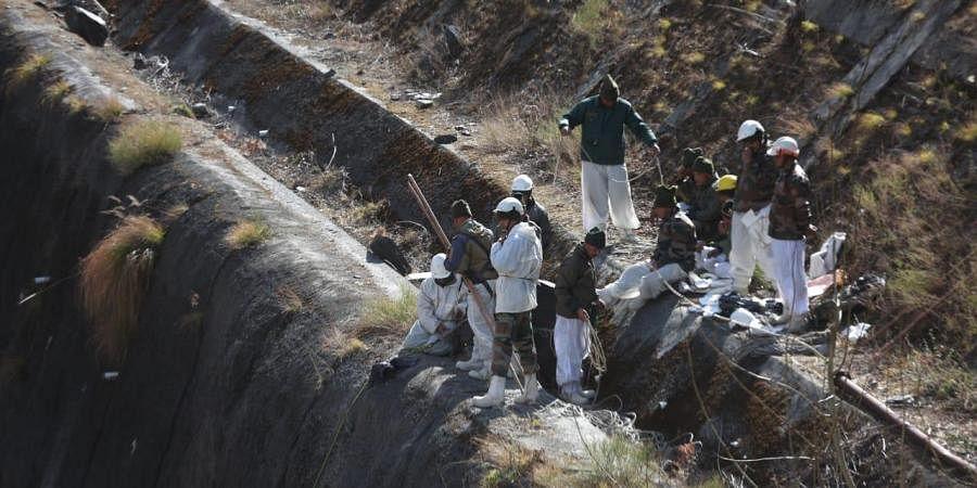Rescue operations underway near the damaged Dhauliganga hydro power projectat Raini village in Uttarakhand