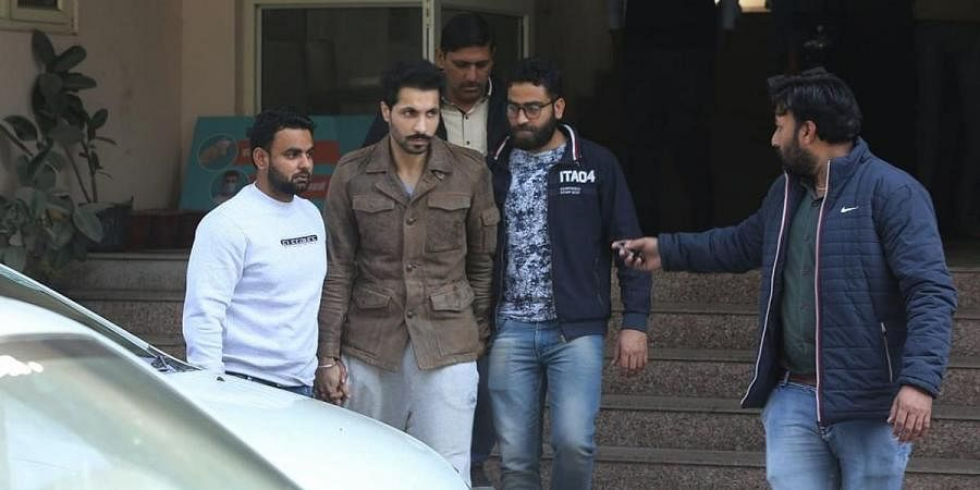 Accused Deep Sidhu with officers of Special Cell in Janakpuri, New Delhi. (Photo | Express)