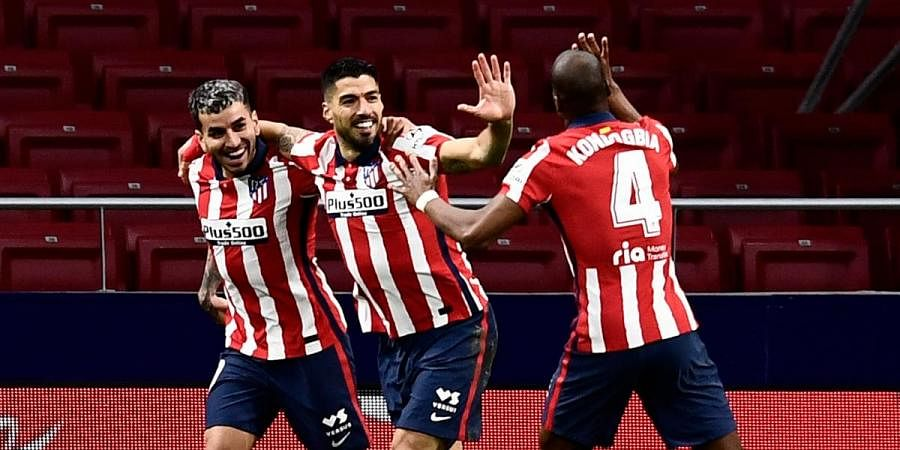 Atletico Madrid's Luis Suarez (C) celebrates with teammates after scoring during a La Ligamatch against Celta at Madrid