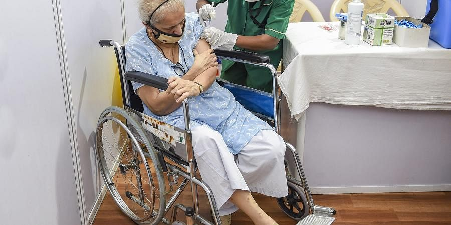 An elderly person being administered the COVID-19 vaccine, during a countrywide inoculation drive, at BKC jumbo vaccination centre in Mumbai, Monday,