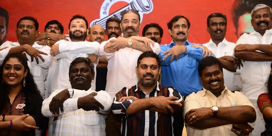 MNM party founder Kamal Hassan poses with candidates for the assembly election 2021 at a hotel in Chennai.