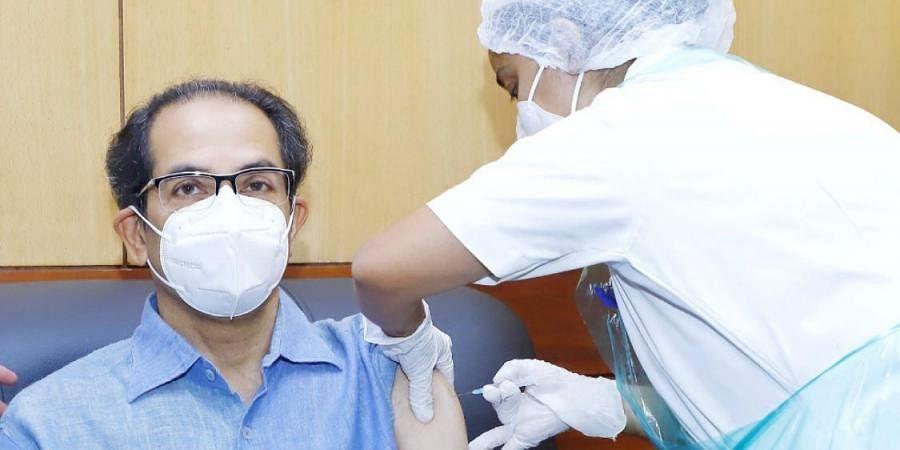 Maharashtra CM Uddhav Thackeray receiving the first dose of coronavirus vaccine. (Photo   Uddhav Thackeray, Twitter)