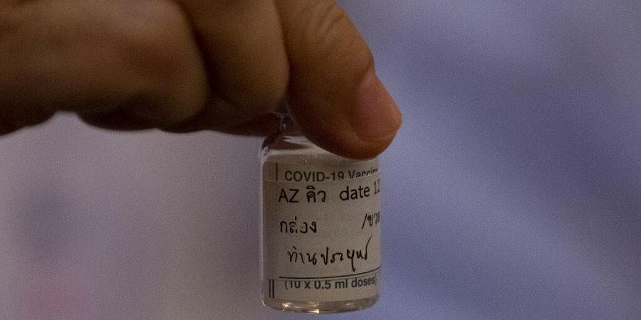 A health worker holds a bottle of AstraZeneca COVID-19 vaccine with name Thailand's Prime Minister Prayuth Chan-ocha written on it, at Bamrasnaradura Hospital in Bangkok. (Photo | AP)