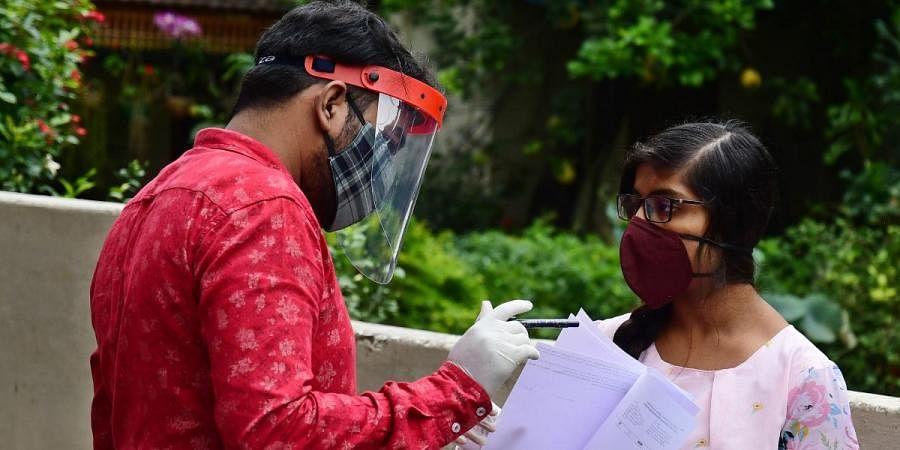 Candidates, who came to write NEET exams, were seen at BBUL Jain Vidyalaya at South Bengaluru