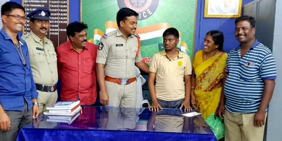 SI Ch Chinna Babu hands over Siddharth to her aunt on Thursday | Express