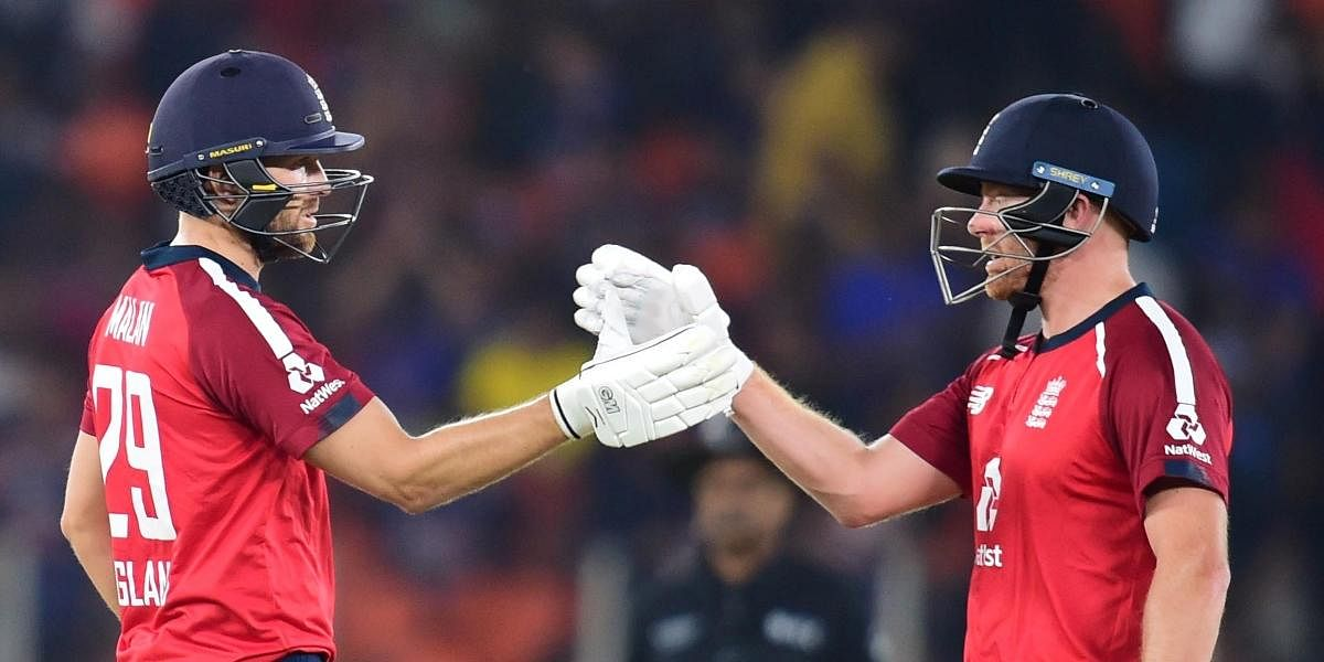 England batsmen Jonny Bairstow and Dawid Malan celebrate their victory in the first T20 cricket match against India at Narendra Modi Stadium in Ahmedabad, Friday, March 12, 2021.