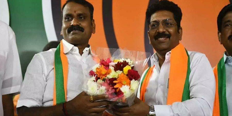 DMK MLA P Sarvanan (right) joins BJP in Chennai