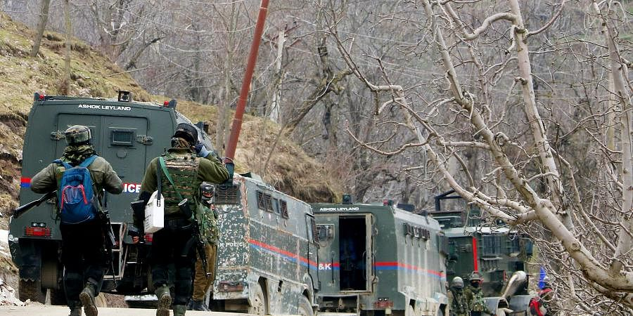 Indian Army personnel arrive to take position during an encounter with terrorists in Shopian on Monday.