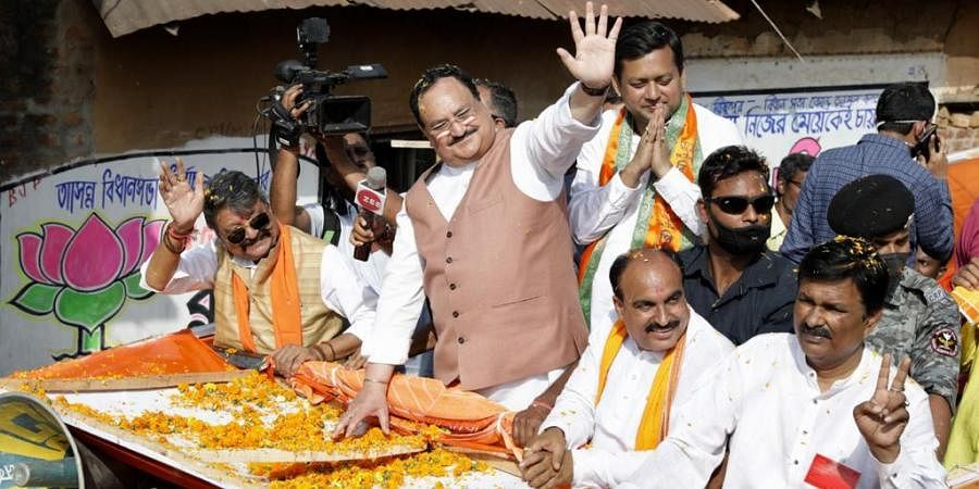 Standing on top of a decorated lorry BJP president J P Nadda conducted a roadshow in the Bishnupur area of Bankura district