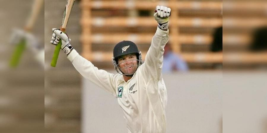Former New Zealand batsman Nathan Astle celebrates his fastest-ever double ton