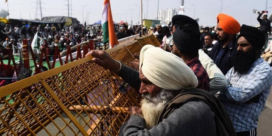 Farmers during their protest against Centres farm laws at Ghazipur border in New Delhi.