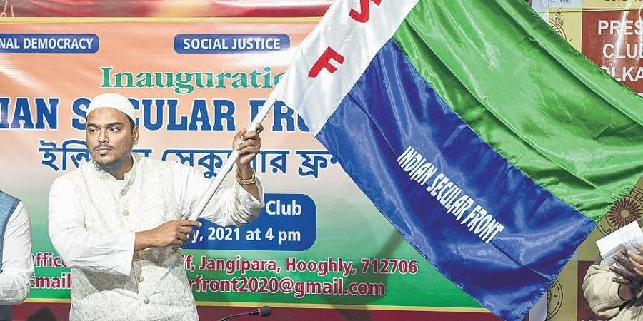 Islamic cleric Abbas Siddiqui of Furfura Sharif waving the flag of the newly-floated Indian Secular Front at Hooghly on Thursday.