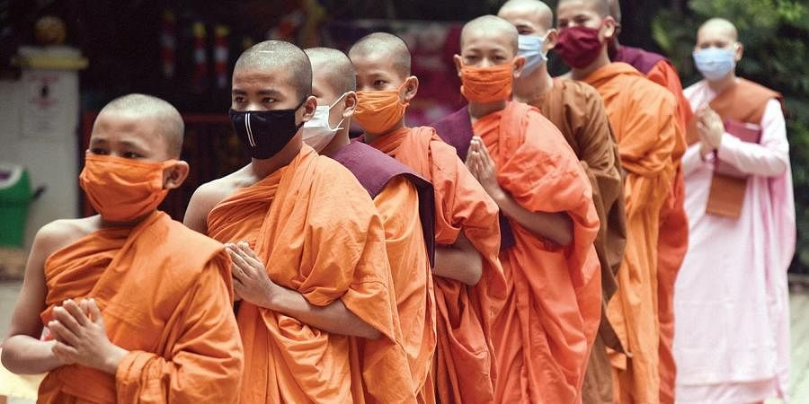 The infected monks, a majority of whom are reported to be asymptomatic, have no travel history and are being quarantined within the monastery compound.