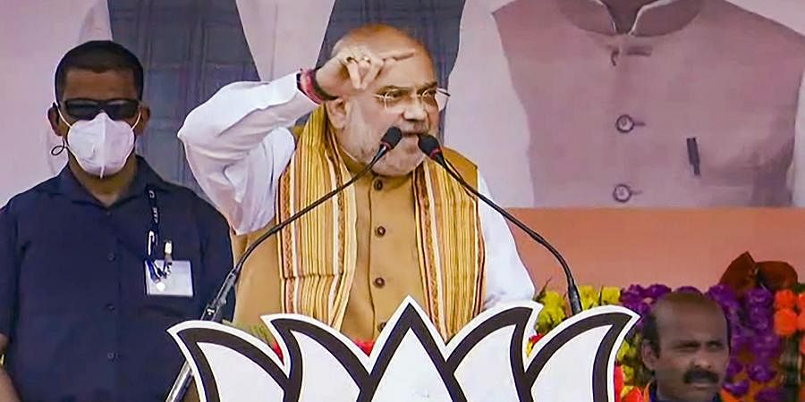 Union Home Minister and BJP leader Amit Shah speaks during an election campaign rally, ahead of West Bengal assembly polls, at Egra in Purba Medinipur district, Sunday,