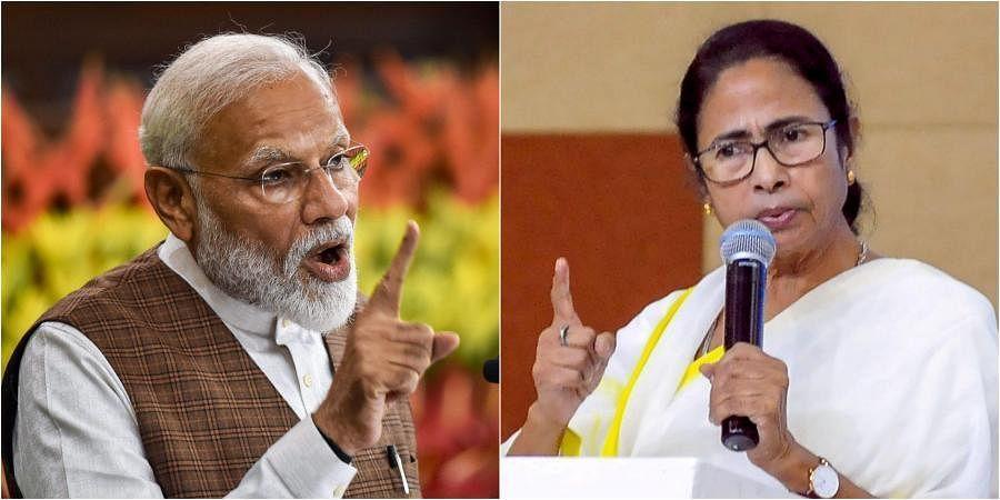 Prime Minister Narendra Modi (L) and West Bengal Chief Minister Mamata Banerjee