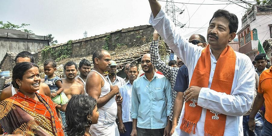 BJP leader Rajib Banerjee during his door-to-door campaign for West Bengal Assembly polls, in Howrah district, Sunday