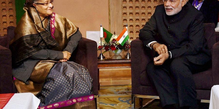 Prime Minister Narendra Modi in a meeting with his Bangladeshi counterpart Sheikh Hasina in Kathmandu. (File photo | PTI)